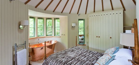 bed and bath at harptree court yurt treehouse in bristol